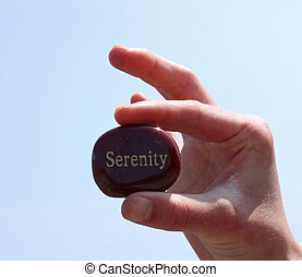 rock with serenity written on it. - A stone with the word...