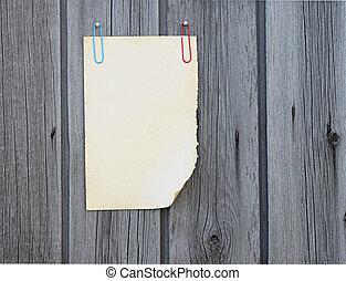 Blank note paper on wood board