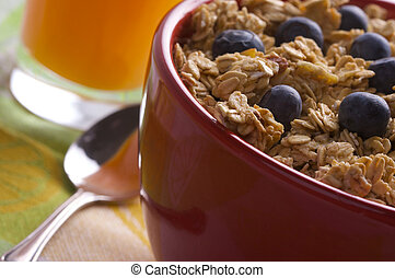 Bowl of Granola and Boysenberries - Bowl of Granola Cereal...