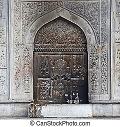An istanbul mosque  door in Turkey decorated with an intricate arabic style metal grating