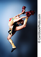 athletic - Beautiful girl cheerleader posing at studio.