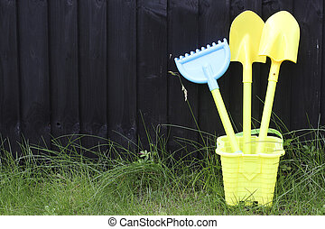 kids gardening kit in the backyard garden