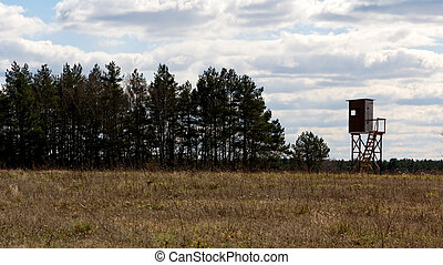Raised Blind in a Spring Field - Line of trees and hunter's...