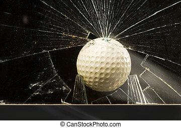 Golf Ball. - Golf ball through broken glass window.