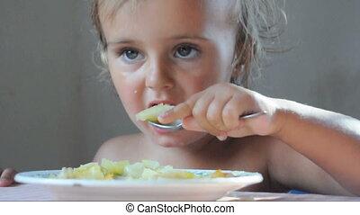 toddler eating dinner - toddler child eating dinner