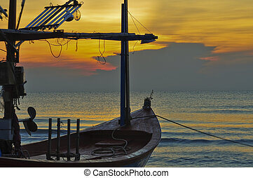 small fishing boat on Hua Hin beach,Thailand in the morning