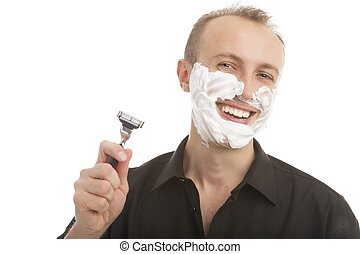 handsome man preparing to shave - portrait of a funny young...