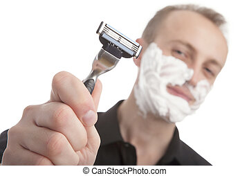 man with his shaving razor - portrait of a young caucasian...