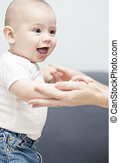 happy baby boy learning to walk - loverly portrait of a...