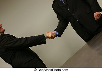 Business handshake - close up of two people shaking hands