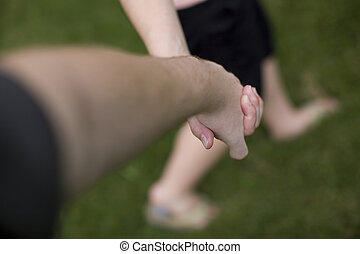 couple holding hands - male female couple holding hands