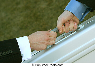 business exchange - close up of two business men hands...