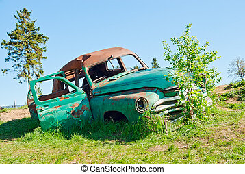 A car wreck - An abandoned rusty car wreck