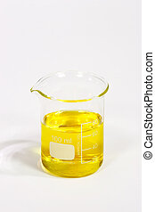 Yellow fluid - Graduated beaker with yellow fluid on bright...