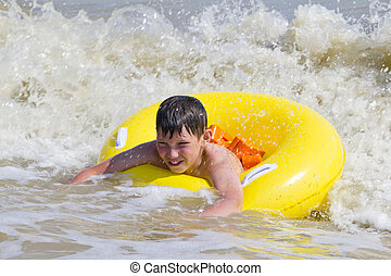 the child is bathed in a sea of yellow rubber circle - the...