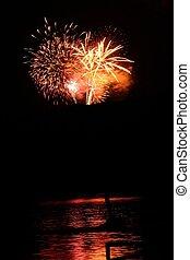 fireworks explode over rural hills