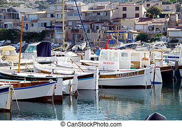 boats in harbor - fishing harbor near marseille
