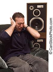 Headache - Man has a headache from listening to loud music