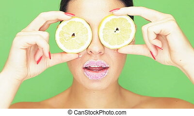 Woman with lemon eyes and puckered