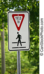 Yield Sign - A yield sign waring of a pedestrian crossing