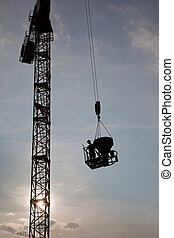 Construction -concrete work - Worker ransporting jib with...