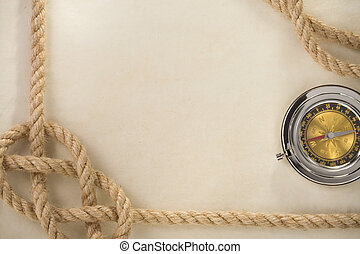 ropes and compass on old vintage ancient paper background...