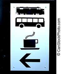 SIGN WITH SYMBOLS - A sign with arrow denoting a train, a...
