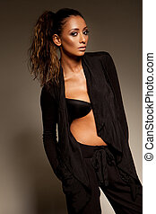 Fashion model in slack suit with unbutttoned top