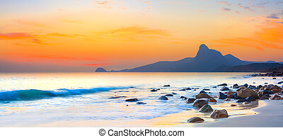 Sunset panorama - Sunset over the sea. Stone on the...