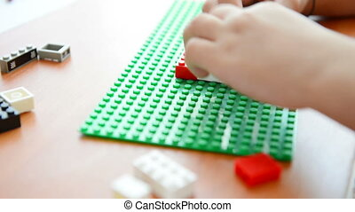 child plays with constructor