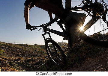 Mountain bike rider in sunset