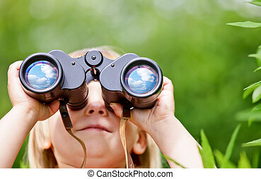 Little girl with binocular - Little girl looking through...