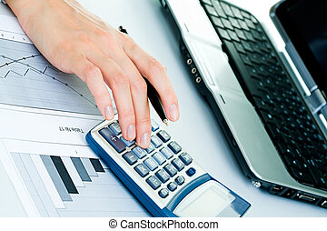 Calculations - Closeup of businesswoman�s fingers...