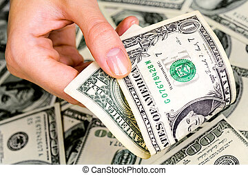 Cash in hand - Close up of woman�s hand with one-dollar...