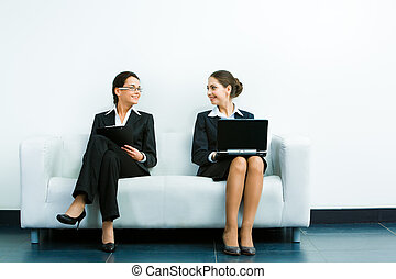 Working businesswomen - Image of two businesswomen wearing...