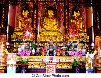 Asian Shrine - Colourful shrine with offerings Thailand this...