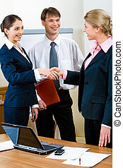 Necessary deal - Image of confident business people standing...