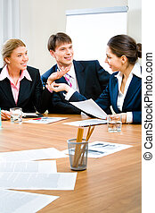 Conversation - Image of three business people sitting at the...
