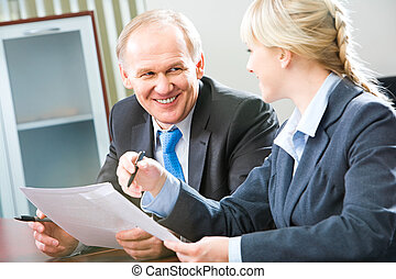 Business interaction - Image of two businesspeople...