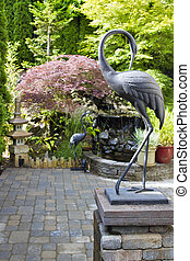 Bronze Cranes in Japanese Inspired Garden - Bronze Cranes...