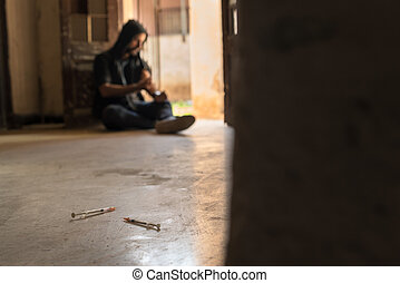 Substance abuse, young man injecting drug with syringe -...