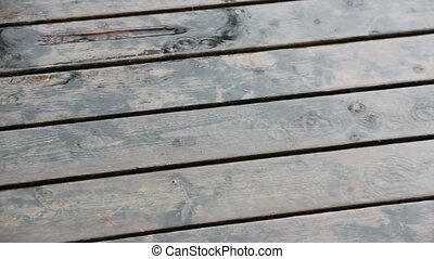 Rain on Deck - Rain falling on wooden deck