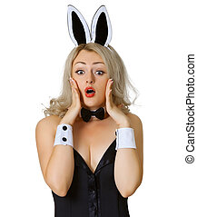 Frightened girl in bunny costume on white background