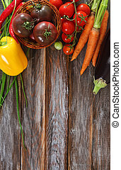Vegetables still life in wooden background with copy space