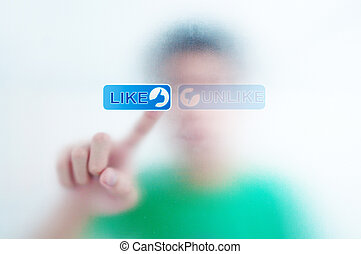 finger pressing Social Network icon on like button