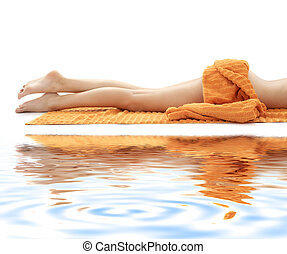 long legs of relaxed lady with orange towel on white sand #3...
