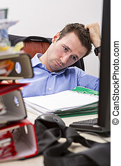 Overwhelmed businessman - Office businessman at his desk...