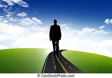 Business man on the empty road leading toward horizon and...