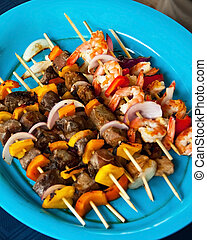 Kebob Variety Plate - Beef, Shrimp, and Chicken skewers on a...
