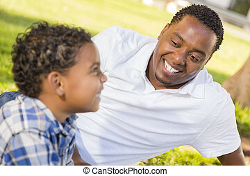 Happy Mixed Race Father and Son Playing - Happy African...